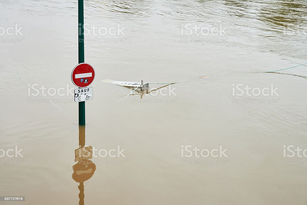 Sign in flooded river Seine in Paris royalty-free stock photo