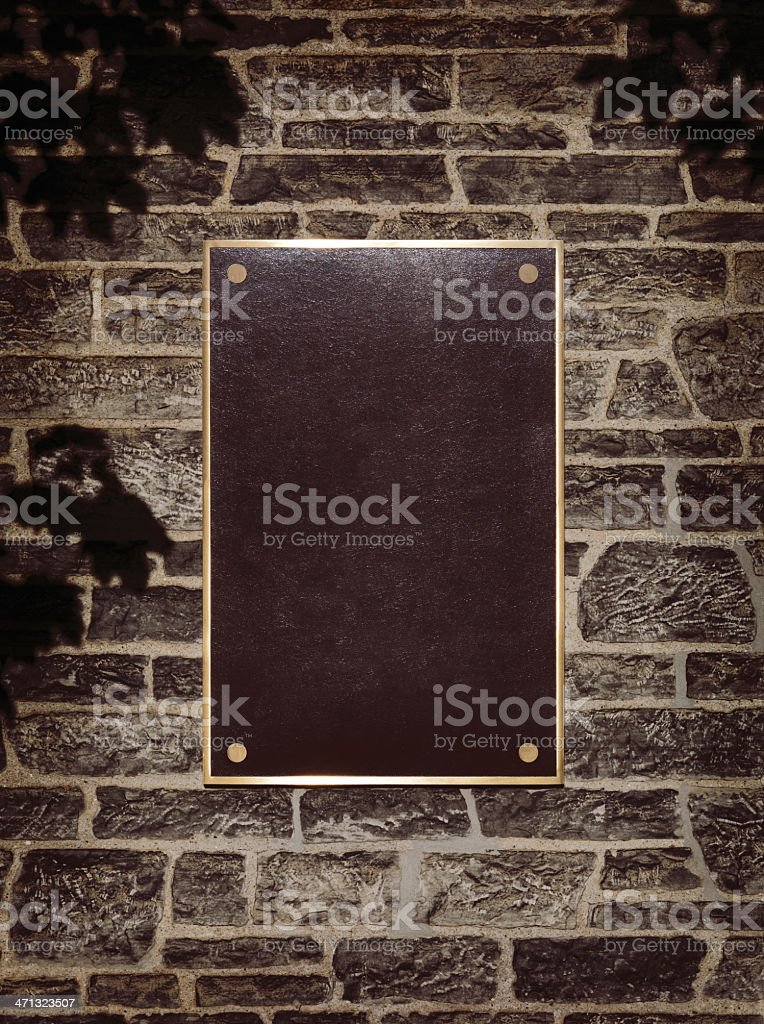 Sign in Metal Frame on a Wall royalty-free stock photo