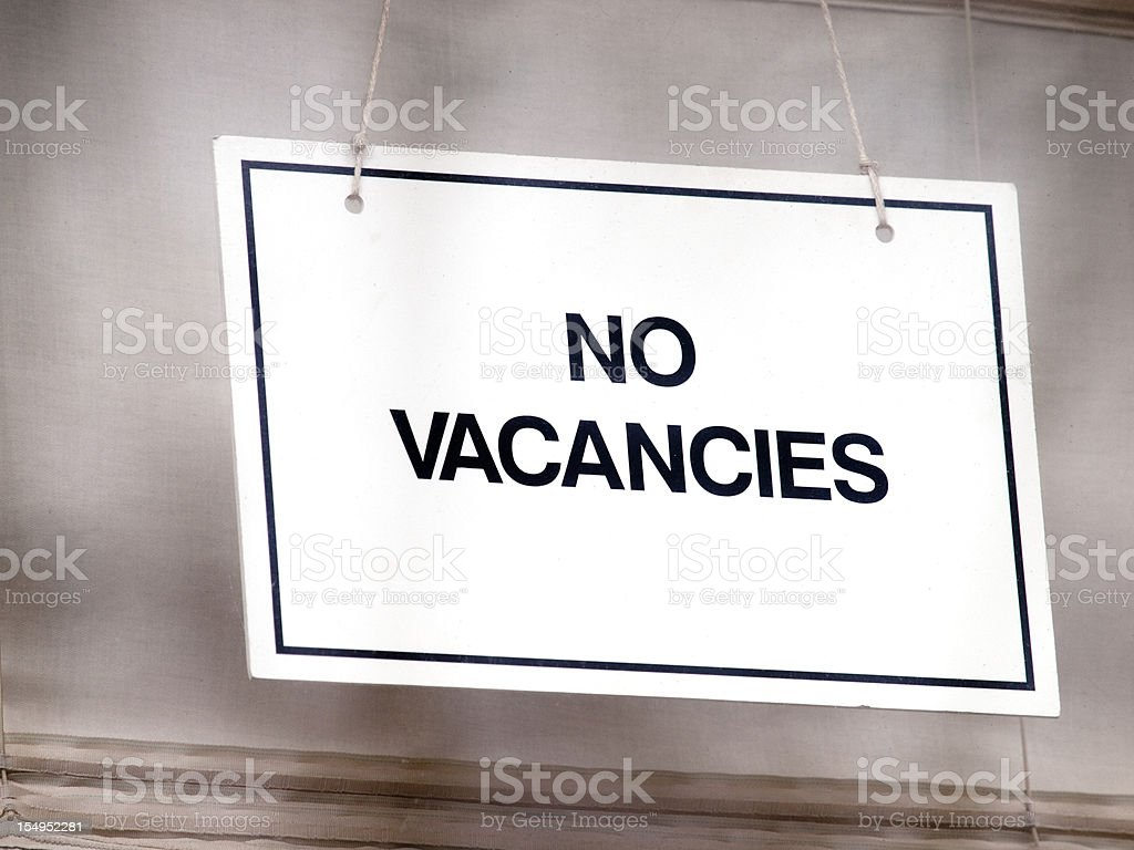 Sign in window of Guest House, saying 'No Vacancies' stock photo