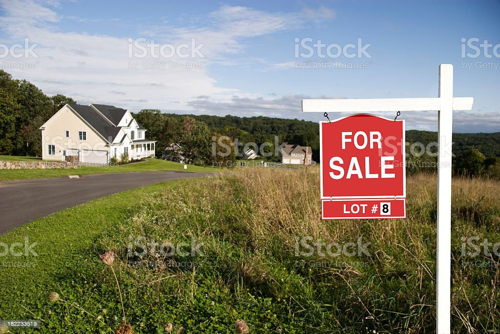 Sign informing of terrain with house for sale royalty-free stock photo