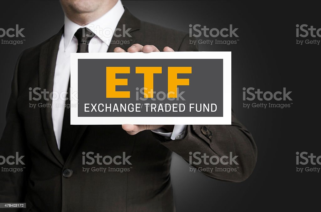 ETF sign is held by businessman stock photo