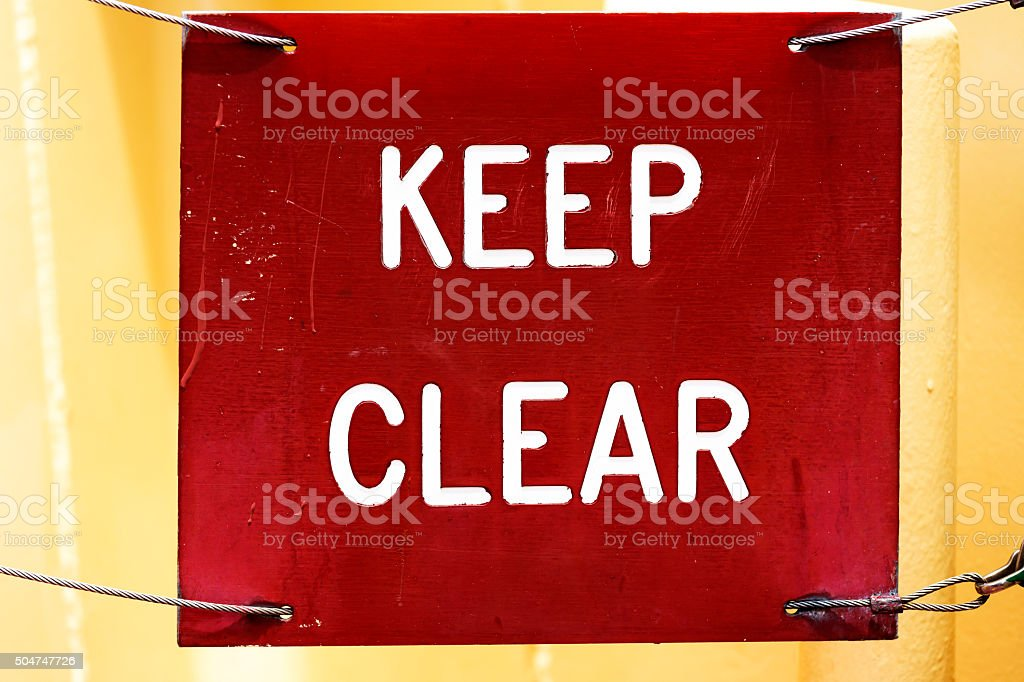 Sign KEEP CLEAR, square red old and damaged sign stock photo