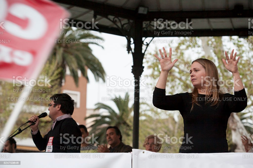 Sign language woman interpreter gestures during a meeting stock photo