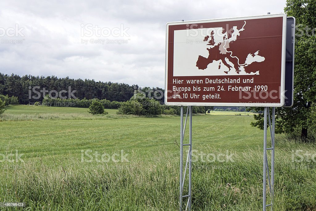Sign marks former border of East and West Germany stock photo