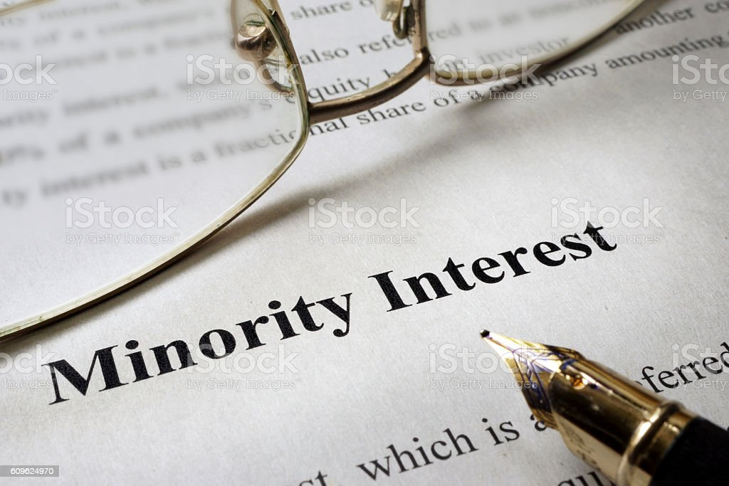 Sign minority interest on a paper and glasses. stock photo