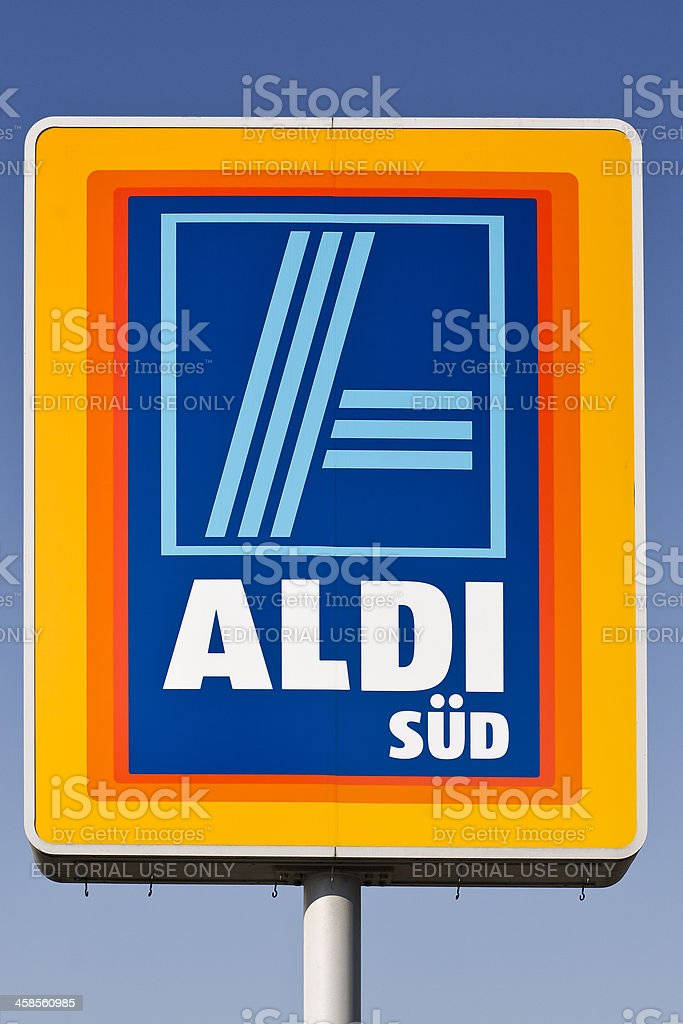Sign of ALDI Store against blue sky. stock photo