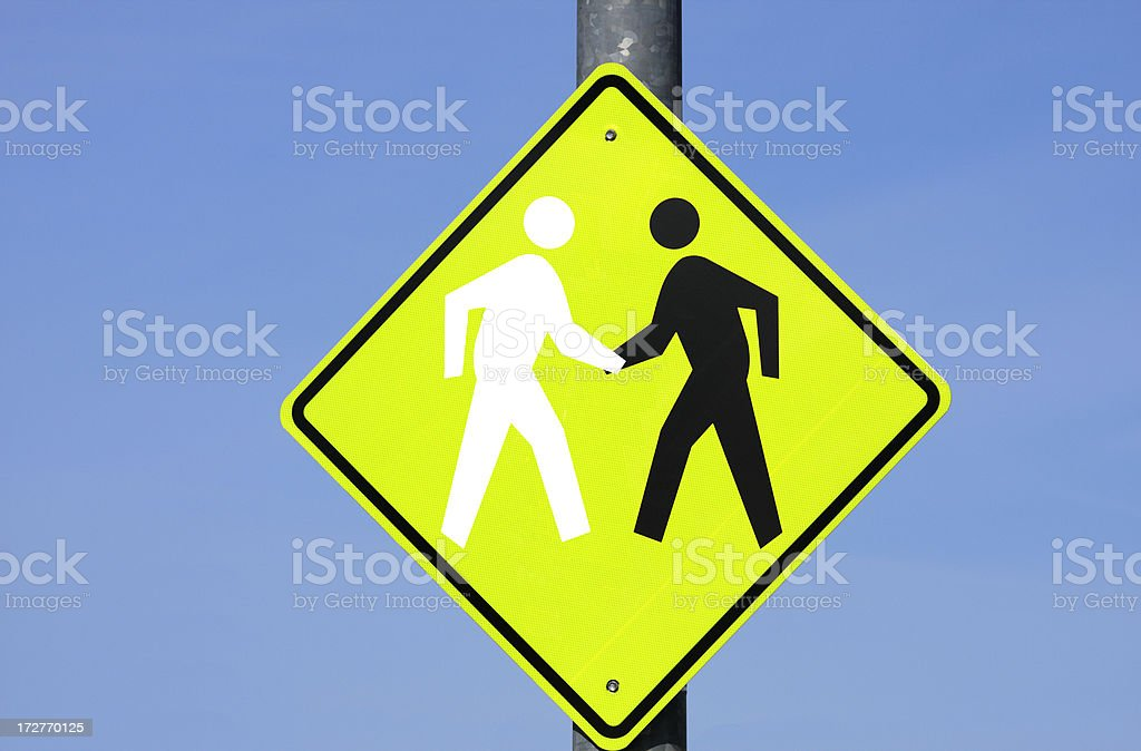 Sign of black & white stick figures shaking hands royalty-free stock photo