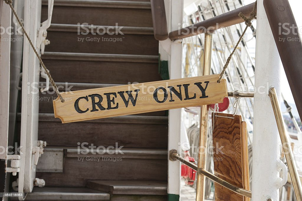 sign of crew only stock photo