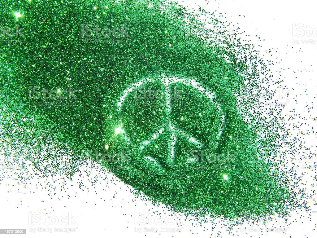 Sign of pacific on green glitter sparkles on white background stock photo