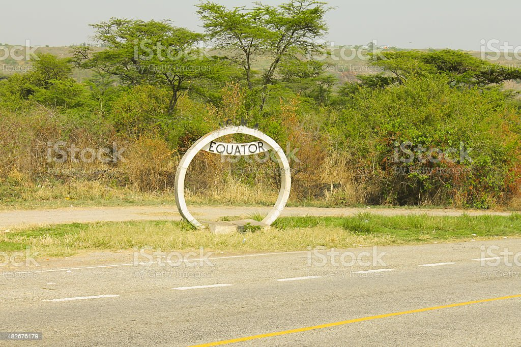 Sign of the equator on the road in Uganda. stock photo