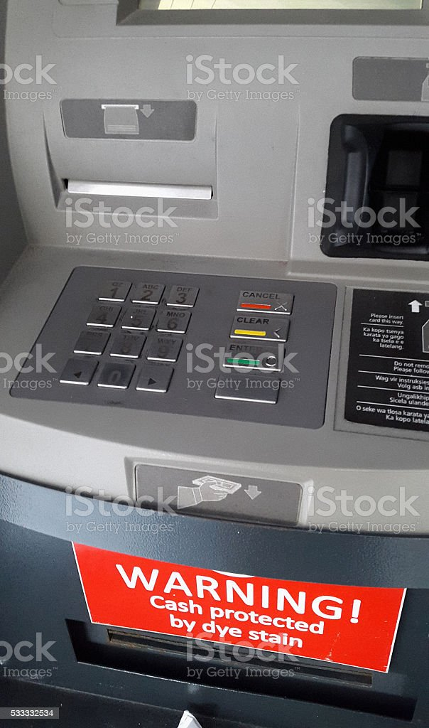 Sign on ATM: Warning! Cash protected by dye stain stock photo