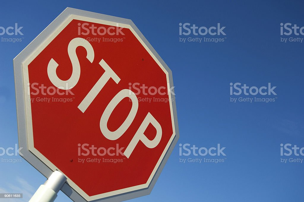 STOP Sign on BLUE stock photo