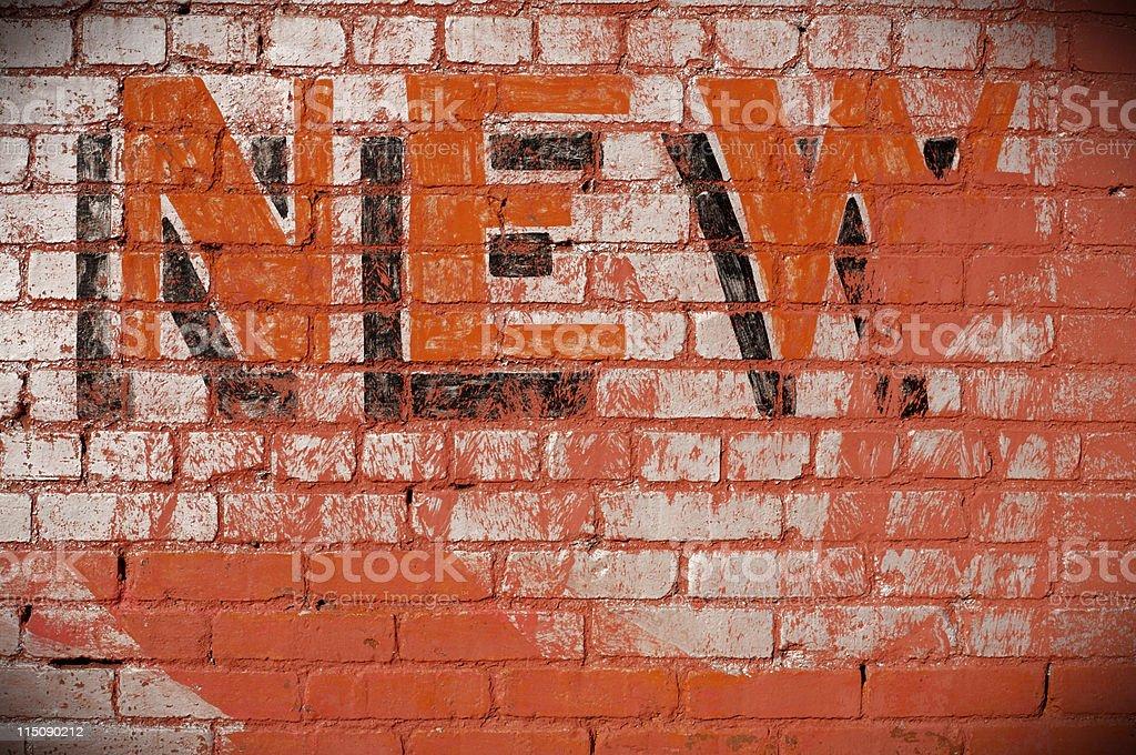 sign on brick wall - new stock photo
