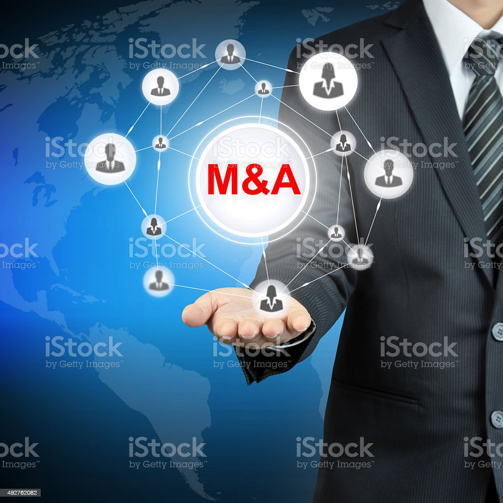 M&A (Merger & acquisition) sign on businessman hand stock photo