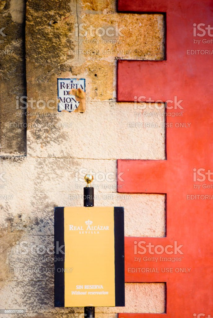 Sign on the exterior wall of Alcazar Castle in Seville stock photo