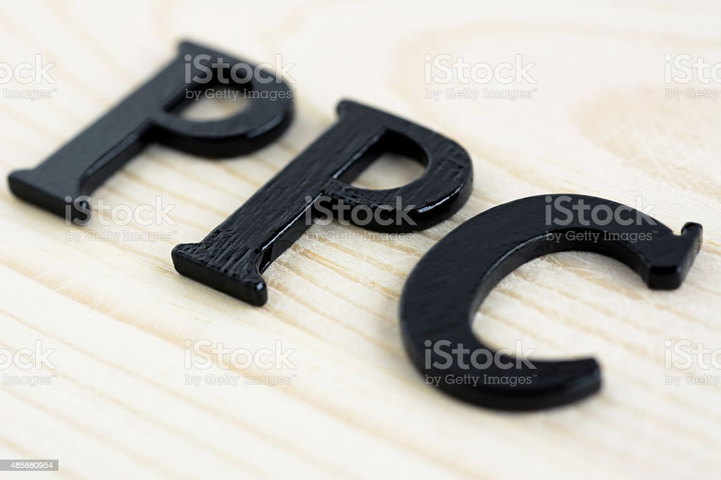 PPC (or Pay Per Click) sign on wood background stock photo