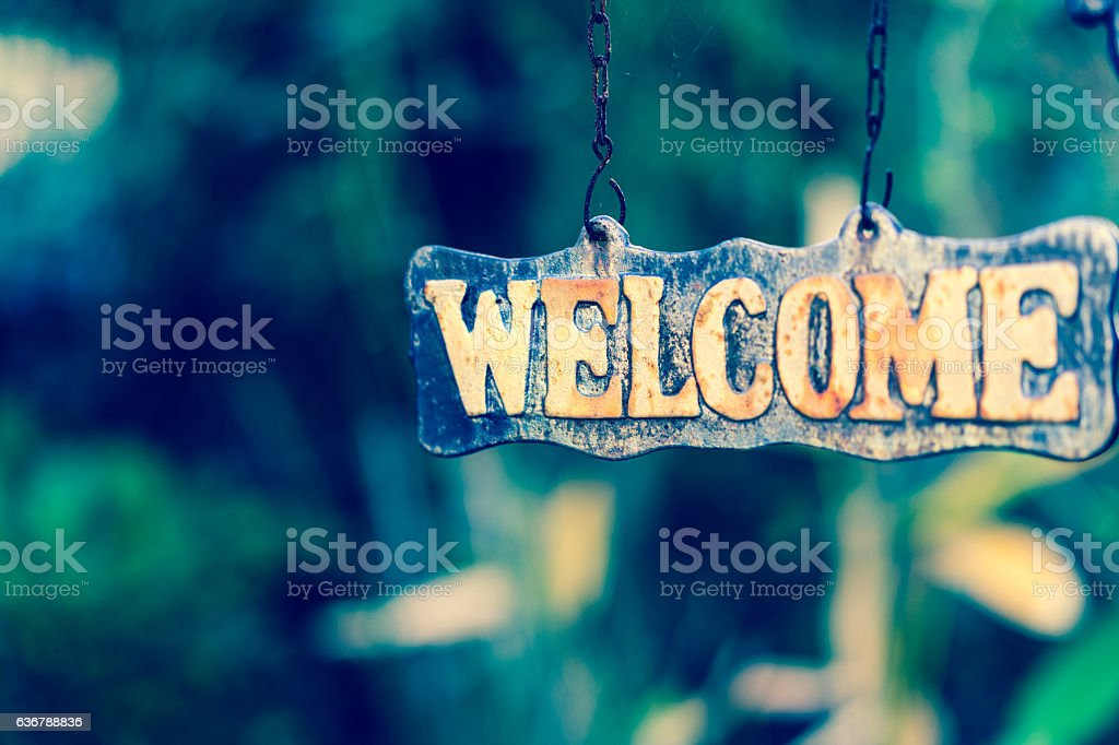 WELCOME sign on wooden board stock photo