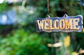 WELCOME sign on wooden board