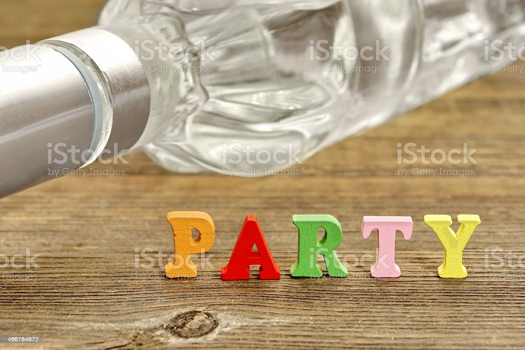 Sign PARTY and Bottle with Vodka stock photo