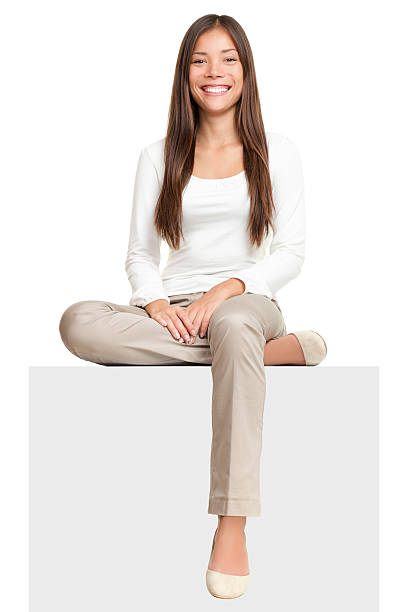 Sign people   woman sitting on signs stock photo. Sitting Pictures  Images and Stock Photos   iStock