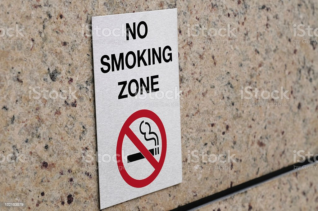 A sign placed on a no smoking zone stock photo