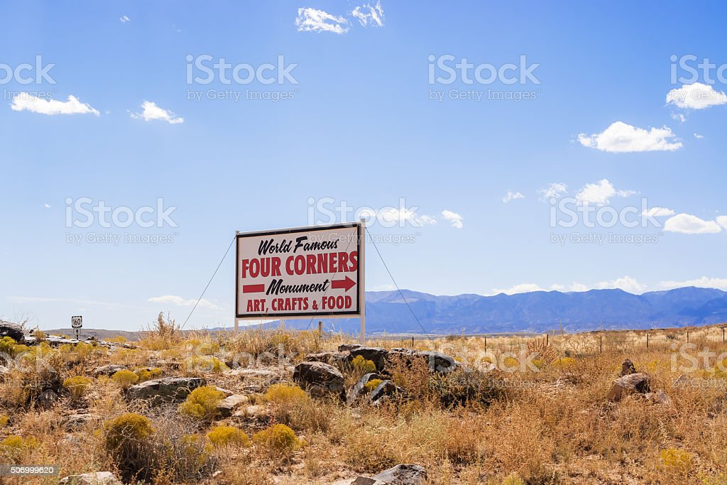 Sign pointing to Four Corners monument in USA stock photo