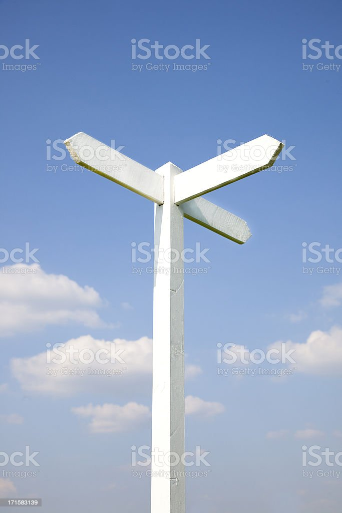 sign post against blue sky royalty-free stock photo