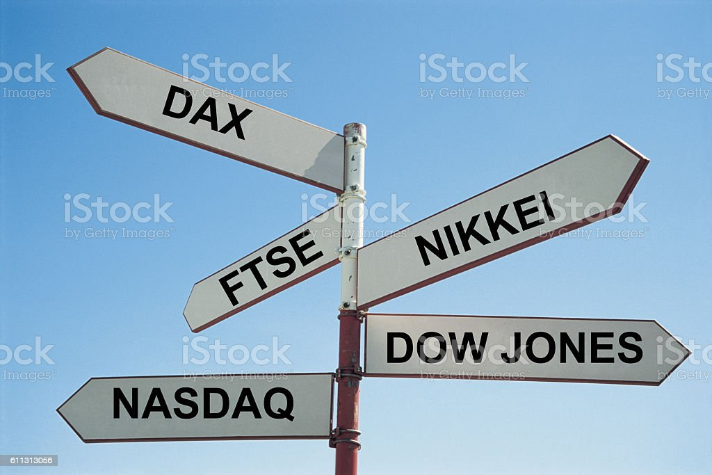 Sign post with various stock exchanges written on them stock photo