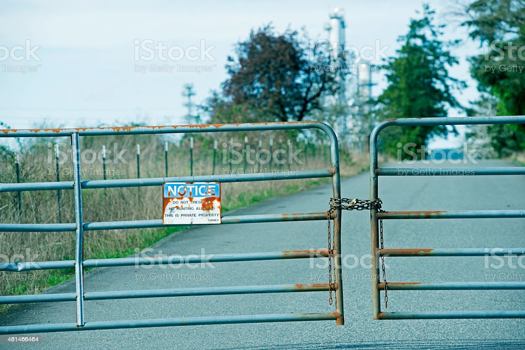Sign posted at entrance of oil refinery in Anacortes WA stock photo