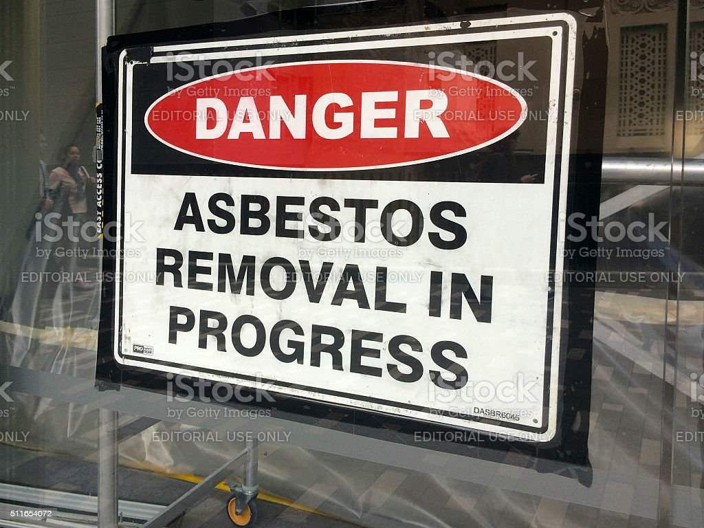 Sign reads: Danger - Asbestos removal in progress stock photo