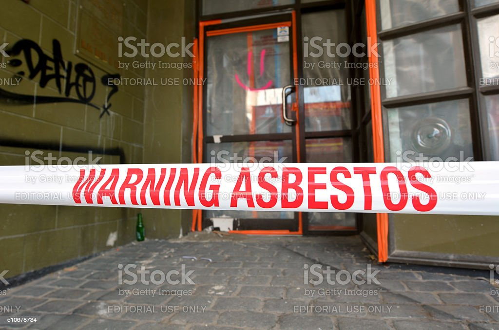 Sign reads: Warning - Asbestos removal in progress stock photo