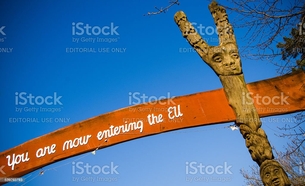 Sign saying 'Your are now entering the EU' leaving Christiania stock photo