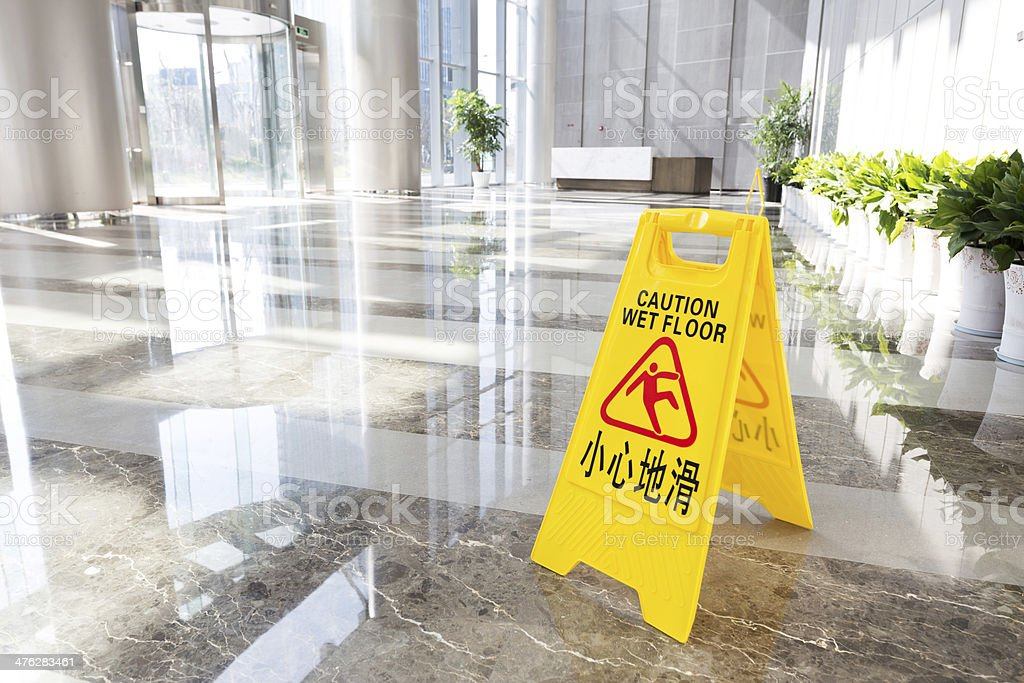Sign showing warning of caution wet floor stock photo
