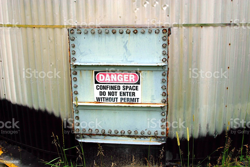 A sign shows that this place is dangerous royalty-free stock photo