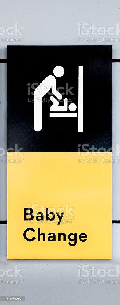 Sign Stating Baby Change with Symbol of Mother Changing Baby stock photo