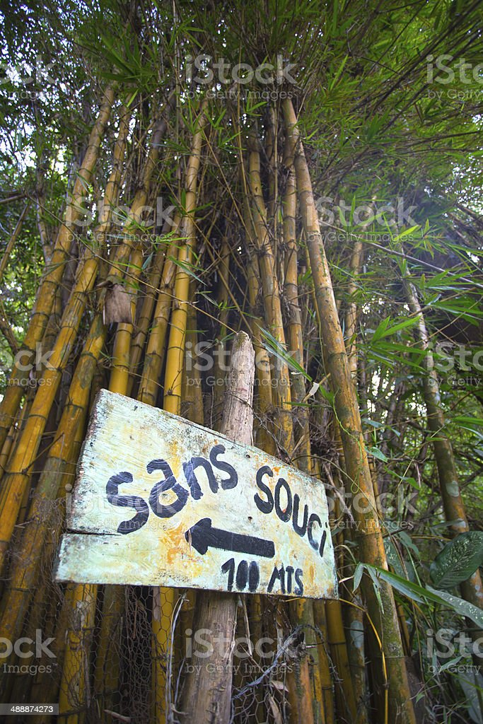 Sign stating no problem in French and bamboo stock photo
