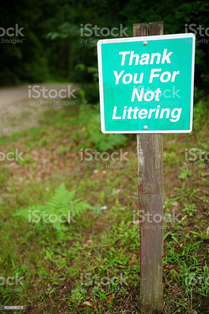 """Sign Stating """"Thank You For Not LIttering"""" Near the Forest stock photo"""