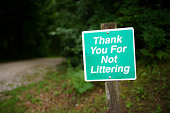"""Sign Stating """"Thank You For Not LIttering"""" Near the Forest"""
