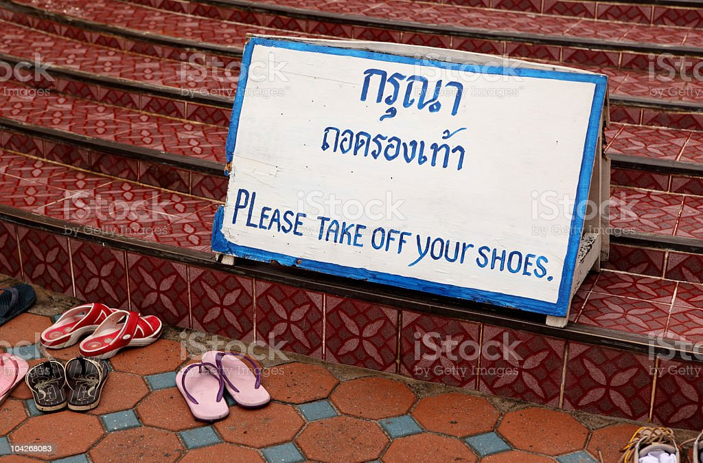 Sign take off your shoes royalty-free stock photo