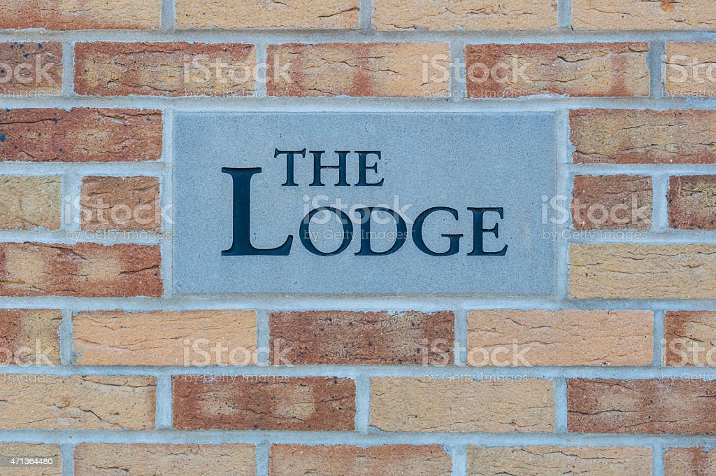 Sign 'The Lodge' on a brick wall stock photo