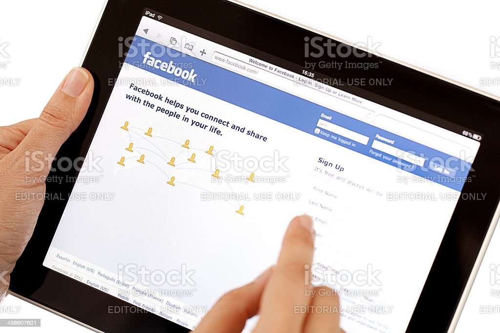 Sign up in Facebook on Apple iPad2 stock photo