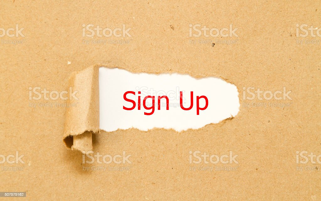 Sign up wprd under torn paper stock photo
