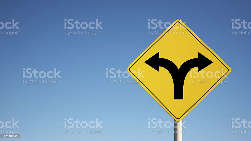 Sign with 2 dividing directions on blue sky clipping path stock photo