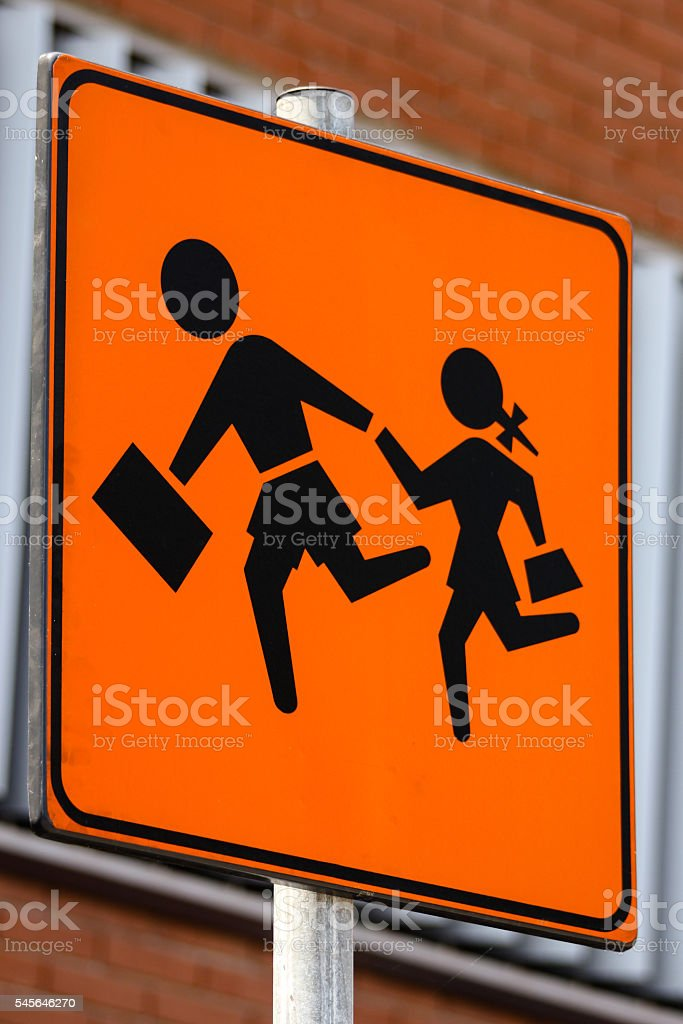 Sign with a man and a girl crossing the street stock photo