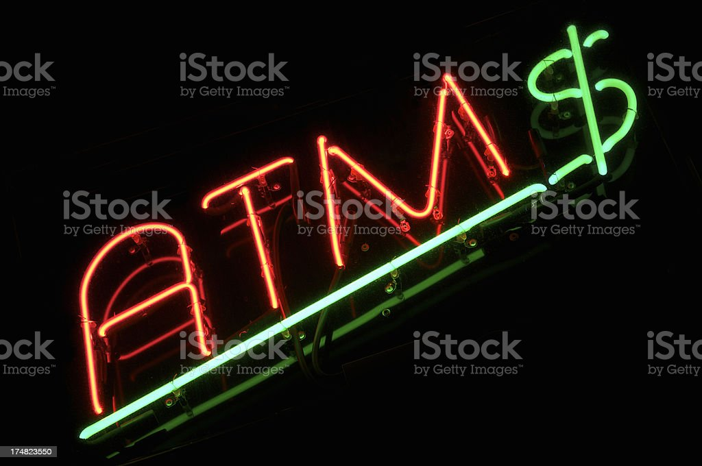 ATM Sign with Green Dollar Black Background royalty-free stock photo