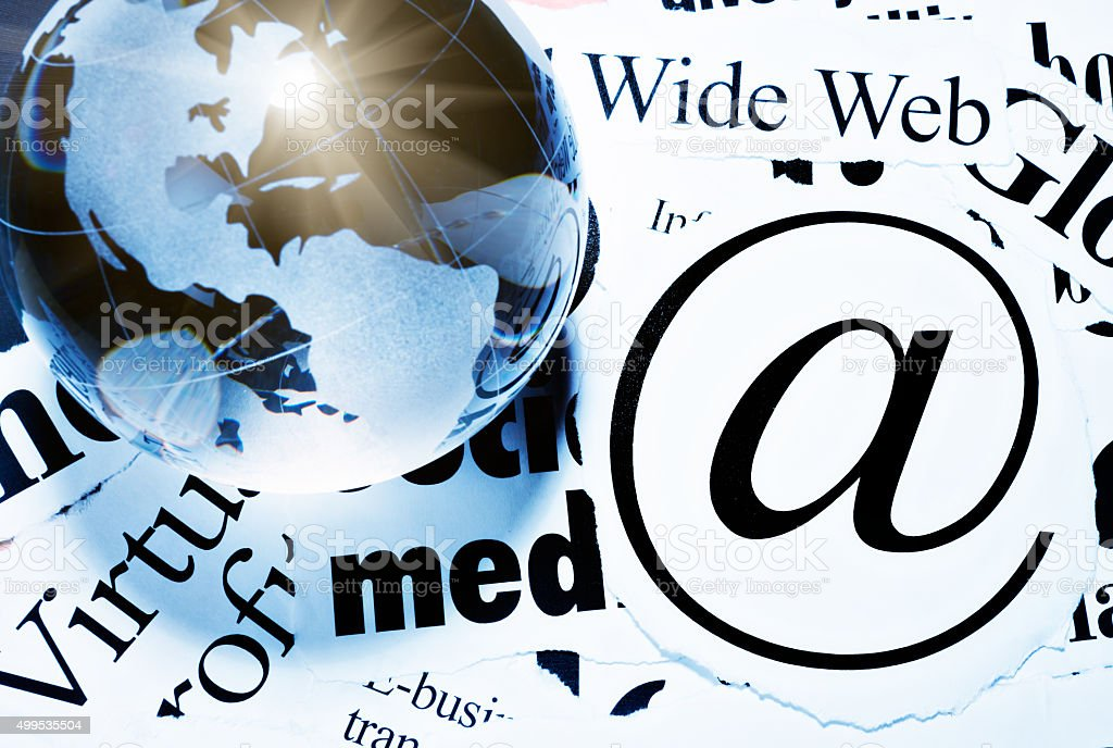 @ sign with internet-related headlines and glass world globe stock photo