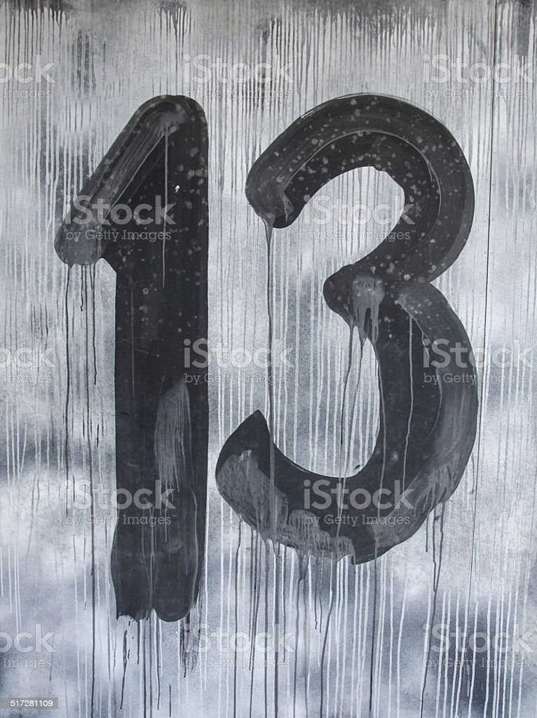 Sign with number 13 in friday night stock photo
