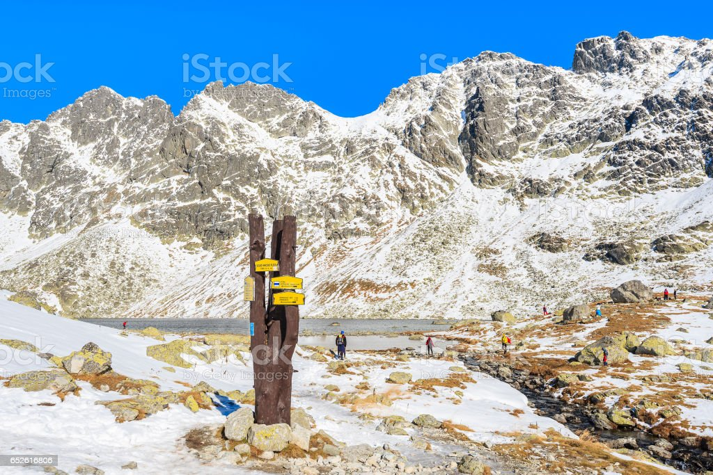 Sign with trail directions in Hincova valley covered with snow, Tatra Mountains, Slovakia stock photo