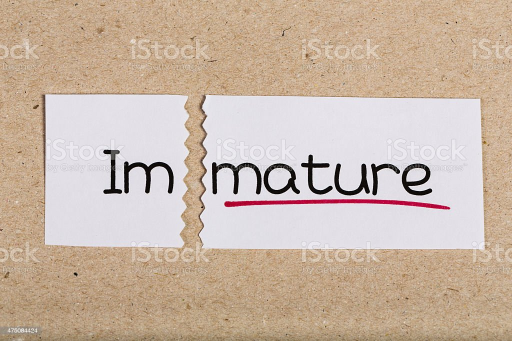 Sign with word immature turned into mature stock photo