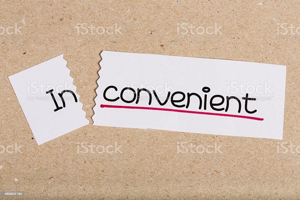 Sign with word inconvenient turned into convenient stock photo
